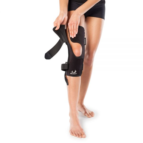Adjustable fit patella tracking knee brace