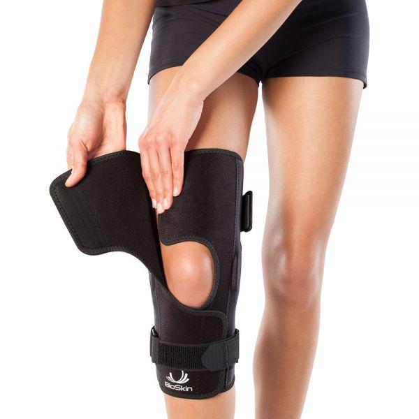 Adjustable hinged knee brace