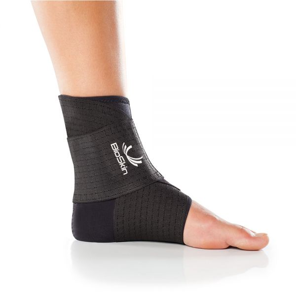 Ankle compression sleeve with supportive wrap