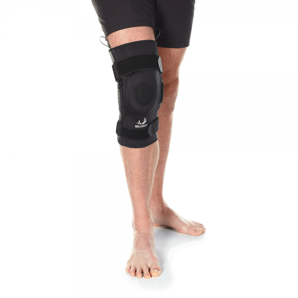 Hinged knee brace with swelling control
