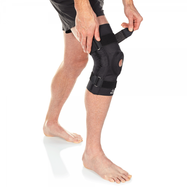 hinged knee brace with patella pad