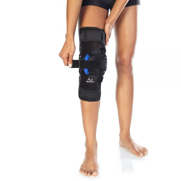 Supportive hinged knee brace wraparound