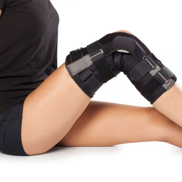 Wraparound range of motion hinged knee brace